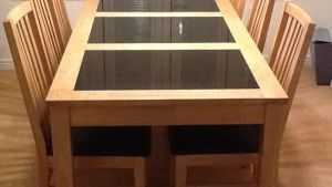 Blonde Wooden Dining Table With Black Inlaid Marble Panels