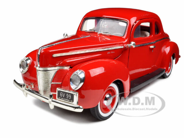 Yellow 1940 Ford Deluxe Coupe