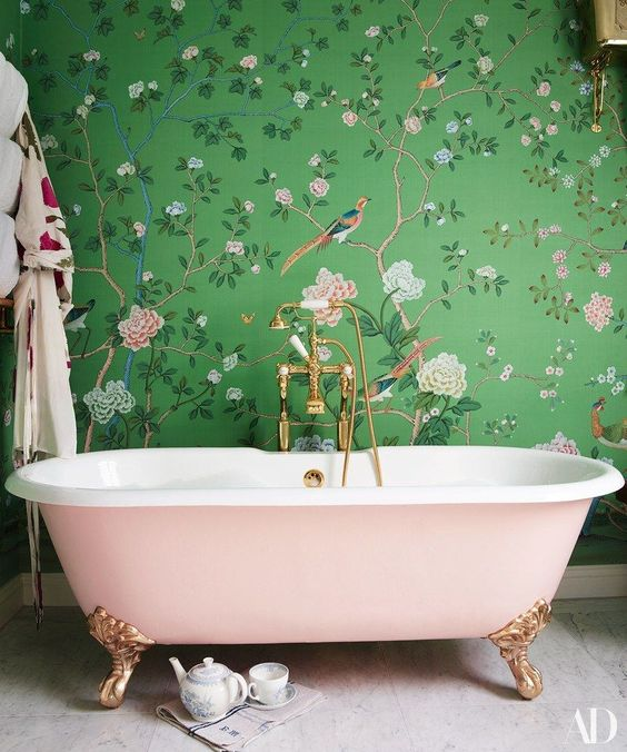 15 Catchy Bathroom Wallpaper Ideas   Shelterness a girlish space with green and pink floral print wallpaper and a blush  bathtub for a