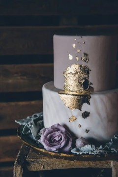 Picture Of marble and purple wedding cake with gold leaf decor