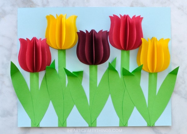 Gorgeous 3D Paper Tulip Flower Craft   I Heart Crafty Things 5  Glue two stems onto each of your paper tulips  To give your flower craft  some extra dimension  fold down some of the tops of the stems
