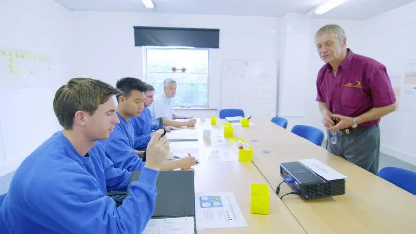 Male Team Of Manual Workers Attending A Company Meeting Or ...