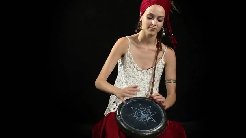 A Female Percussion Drummer Performing With Bongos Stock ...