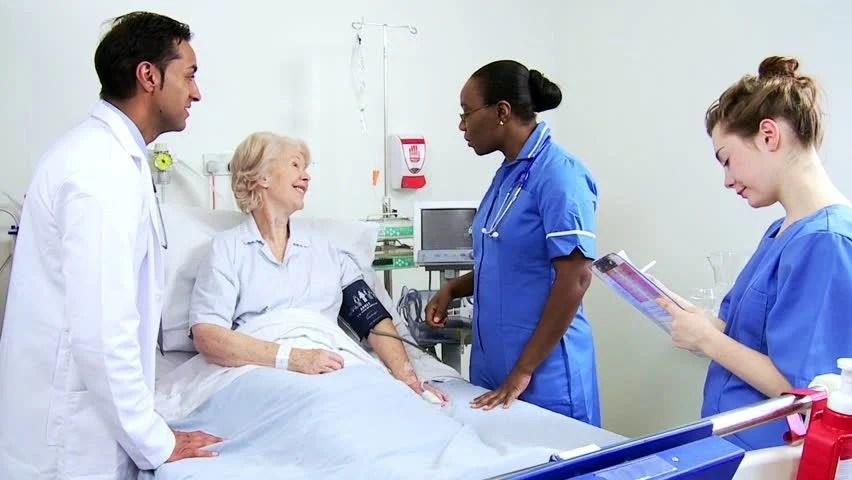 Elderly Female Hospital Patient Having Her Blood Pressure ...