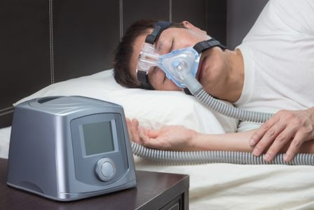 premium photo asian man with sleep apnea using cpap machine