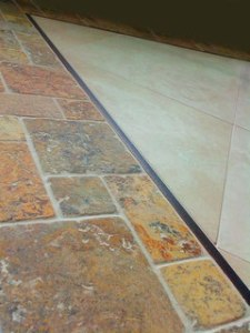 Edge Trim   Tile Lines Travertine tile and mosaic border with a Schluter edge metal liner