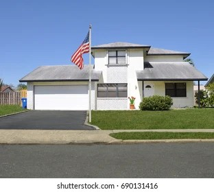 Split Level Ranch Images  Stock Photos   Vectors   Shutterstock American Flag pole Suburban White split level ranch with double wide garage  blacktop driveway blue sky
