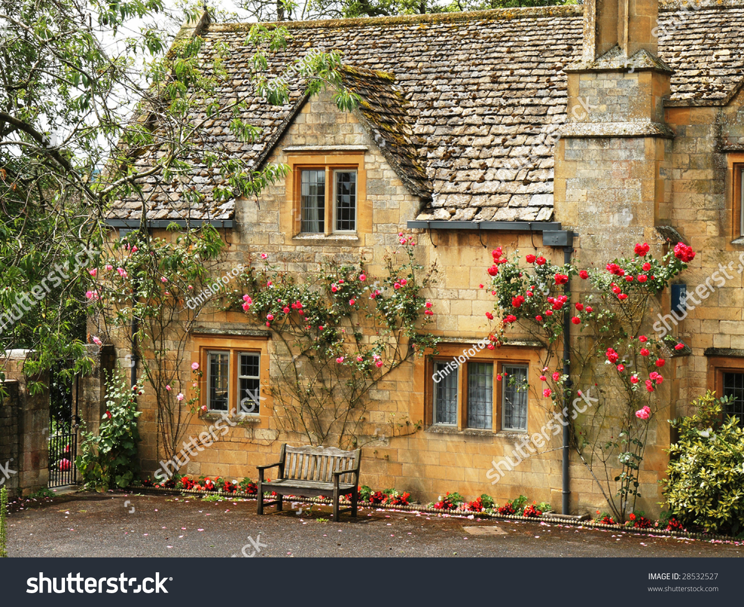 Traditional Stone English Village House Covered Stock
