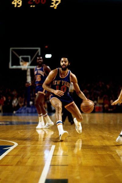 Basketball great Walt Frazier takes a shot against ...