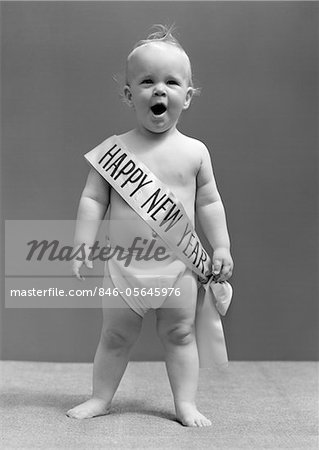 1940s BABY STANDING IN DIAPER YAWNING WEARING HAPPY NEW YEAR SASH     1940s BABY STANDING IN DIAPER YAWNING WEARING HAPPY NEW YEAR SASH   Stock  Photo