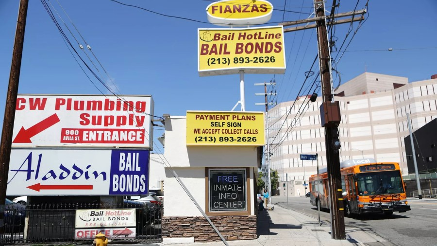 Politics   Axios A small building with various signs and billboards advertising bail bond  payment plans and services