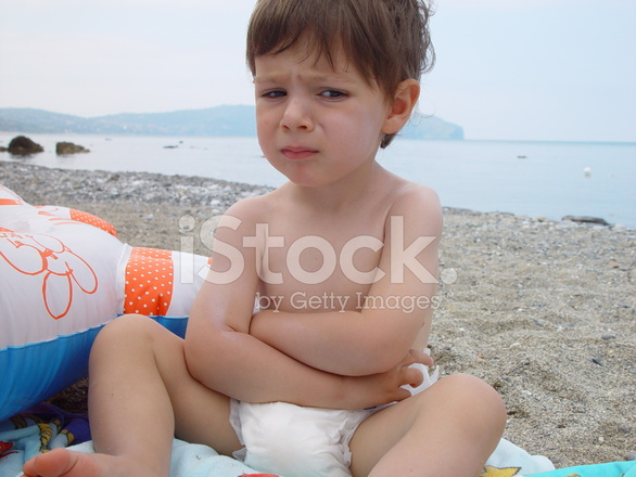 Angry Baby on A Beach With Clouds Stock Photos ...