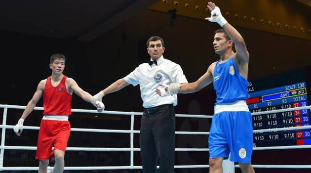 Asian Games boxing  India  Kazakhstan sailing in same boat   The     Jakarta  India s Amit Panghal  Blue  and PR Korea s Ryong Jong during the  Men s Light Fly  46 49kg  Quarterfinal boxing event in the 18th Asian Games  2018