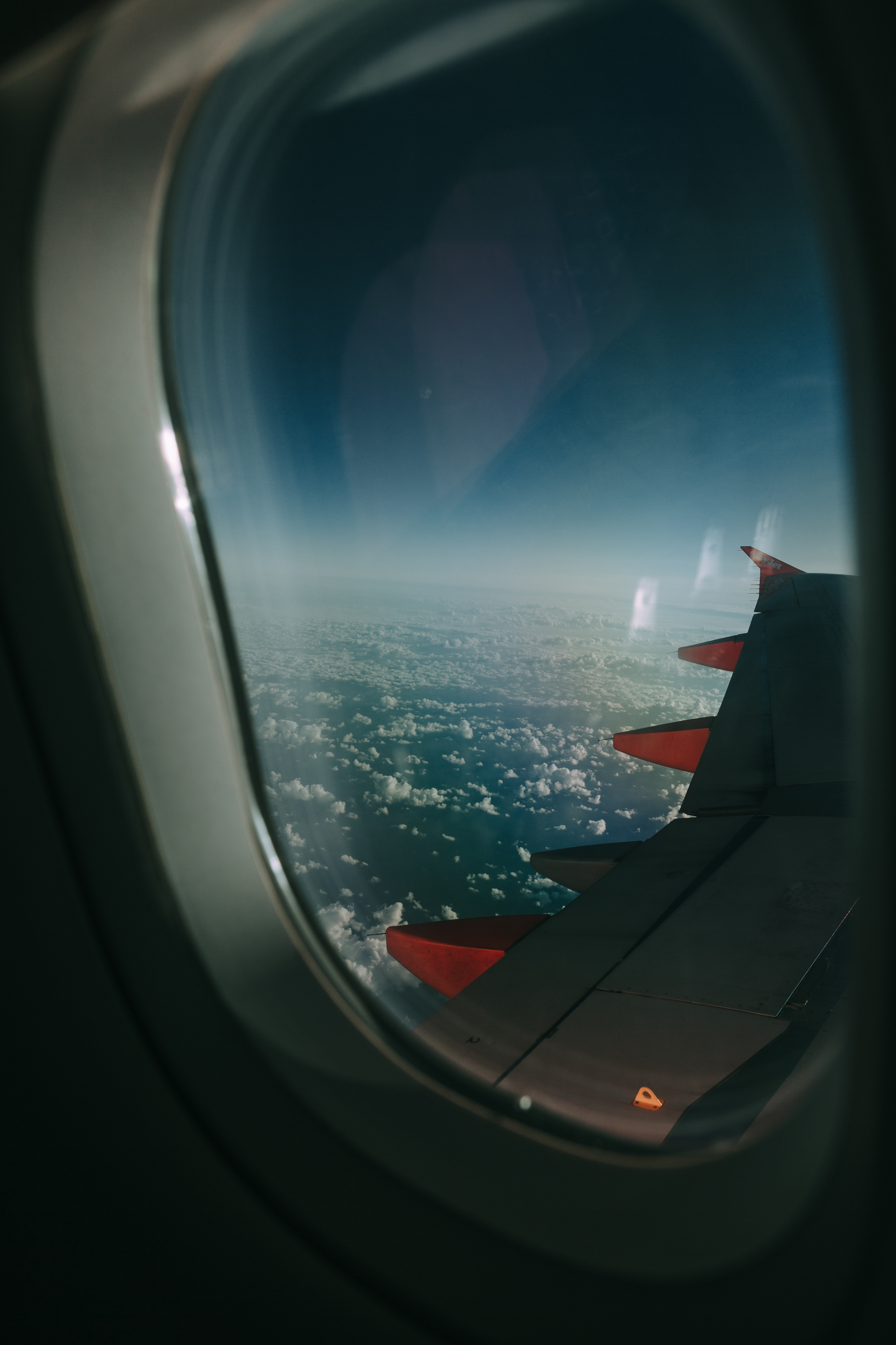 Airplane Window Overlooking Clouds 183 Free Stock Photo