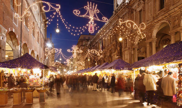 Christmas and new year travel tips for Italy   Short   City breaks     Market at night with lights