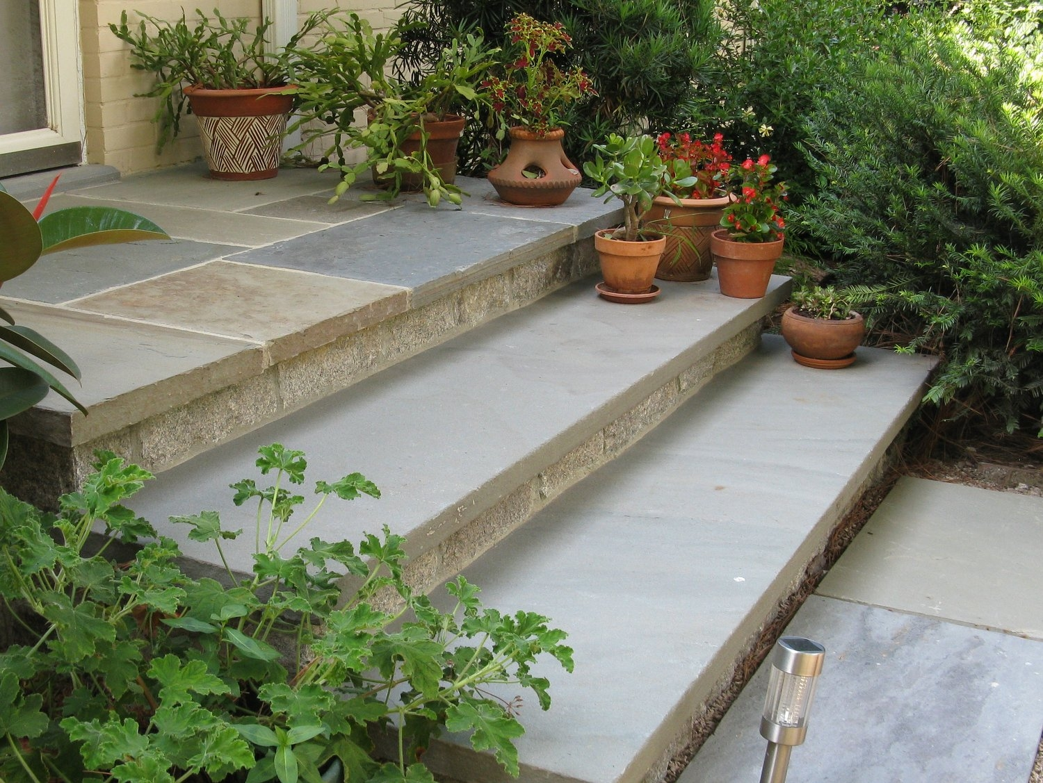 Porches And Steps May Cause Separation Anxiety — European Stone | Stone Front Porch Steps Designs | House | Stained Concrete | Round | Stone Walkway | Flagstone