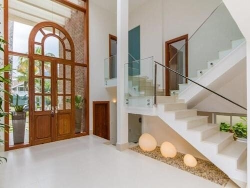 Got An Empty Space Under The Stairs In Your P*Nth**S* Duplex Amp | Duplex Stairs Wall Design | Middle Room Interior Design | Attractive | Staircase Wall Panel | Living Room Layout | Bungalow Duplex Indian