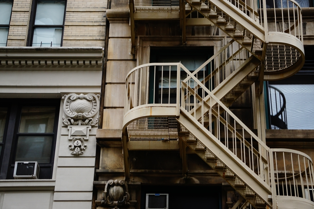 Brown Concrete Building With Metal Stairs Photo – Free Banister | Building A Handrail For Concrete Stairs | Deck Railing | Deck | Steel Handrail | Porch | Outdoor Stair