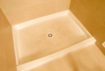 How to Seal a Fiberglass Shower Pan to a Tile Wall   Home Guides     Match the color of caulk to the shower pan for the most unobtrusive seal