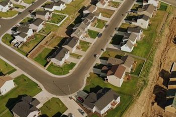 The Difference Between Raised Ranch and Split Level   Home Guides         Ranch and Split Level  An aerial view of suburban homes shows their  exterior uniformity
