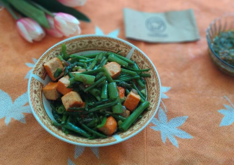 Resep Tumis bunga daun bawang saos Tiram