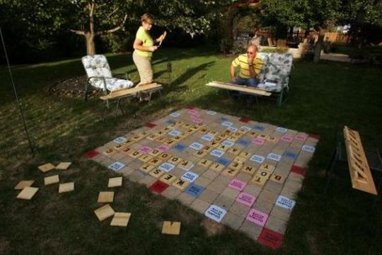 24 Entertaining Wedding Reception Games   EverAfterGuide     indoor game  Everyone loves to play this in their lounge  Make it a  part of your reception by designing a large sized scrabble board and wooden  blocks