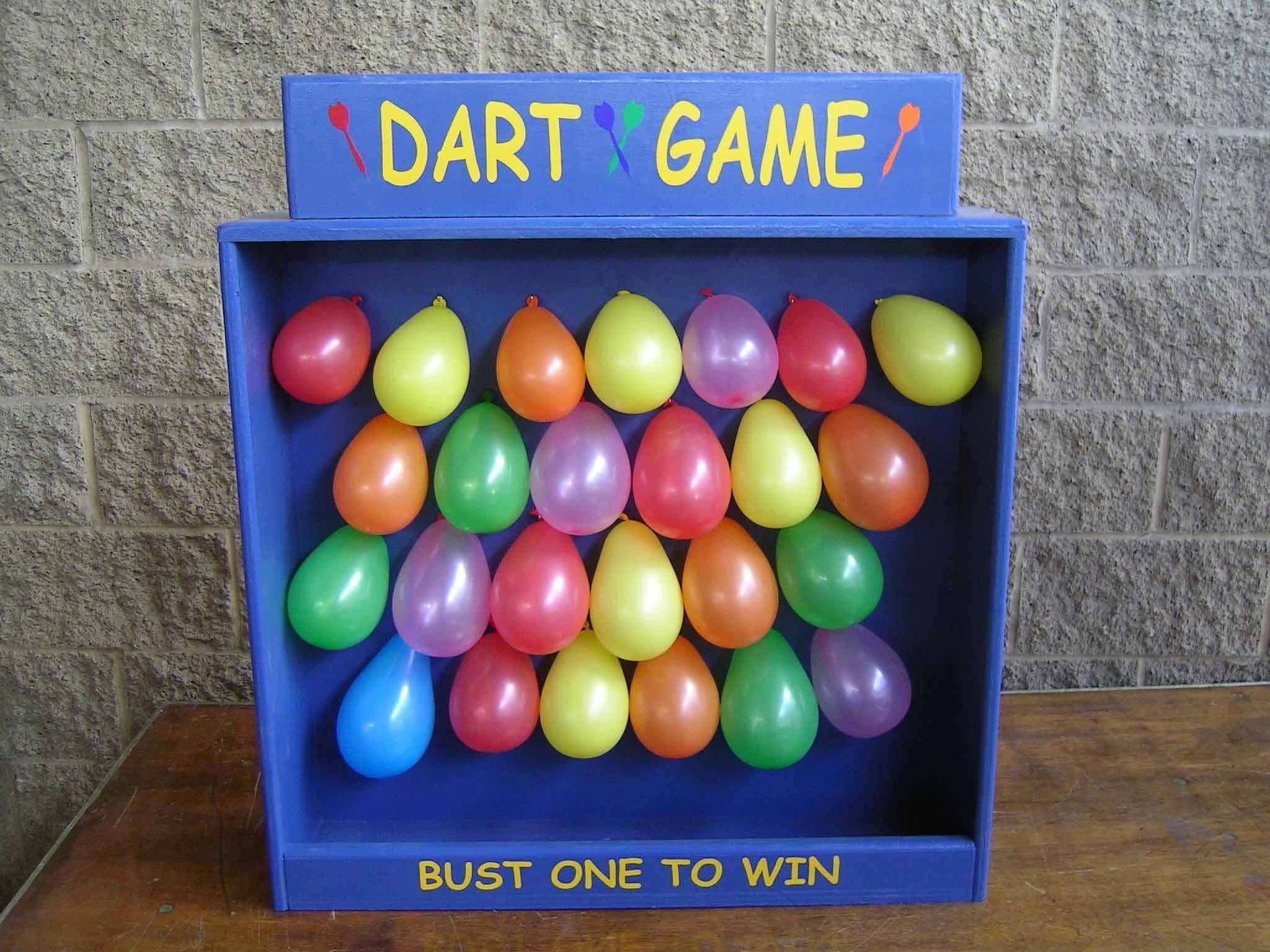 How to Beat Carnival Games   The Best Tricks to Win County Fair Games Throw Hard When You Play Balloon Darts