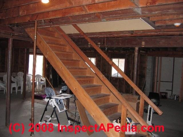 Basement Stairways Guide To Stair Railing Landing Construction | Basement Stairs With Landing | English Basement | Grand Entrance | Spiral | Wood | Hardwood
