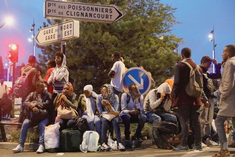 French church to the rescue of migrants  La Croix International Migrants waiting to be evacuated at Porte de la Chapelle in Paris   Photo  by LP Guillaume Georges PHOTOPQR LE PARISIEN MAXPPP