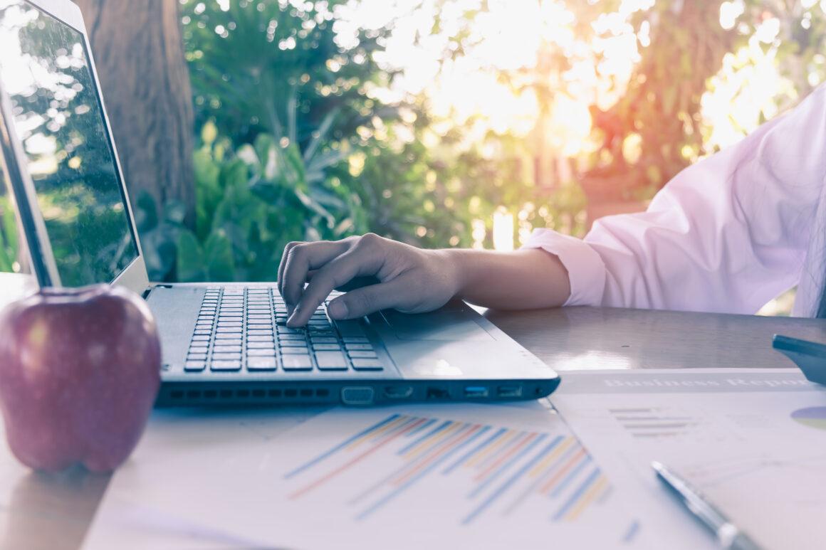 woman working her laptop terrace 1160x773 1