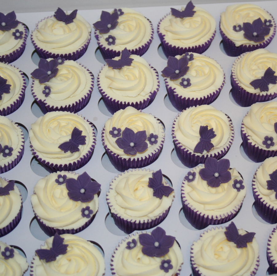 Purple flowers   butterflies wedding cupcakes
