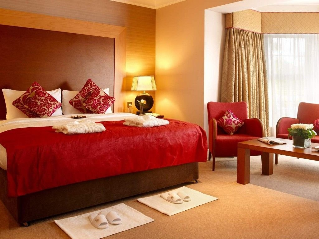Best Amazing Bedroom Interior With Cream Wall Paint Color And Double Small Sofas Design And Red Bed With Pictures