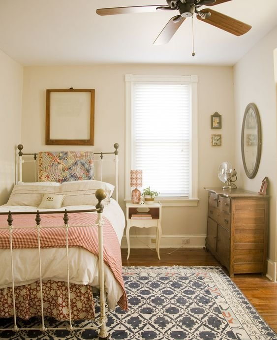 Best A Simple Cottage Bedroom With A Twin Bed With Metal Frame With Pictures
