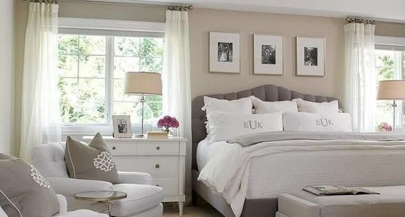 Best Chic Bedroom Features A Sand Colored Accent Wall Lined With Three Black And White Photos Over A With Pictures