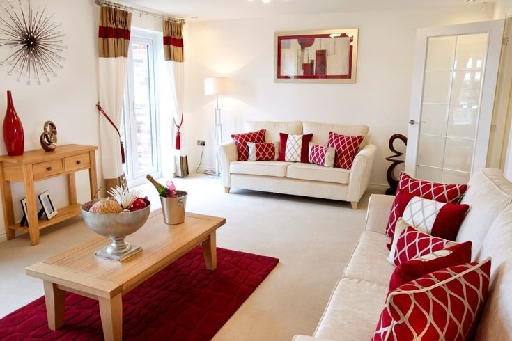 Best Red Hues Complement The Welcoming Cream Interior Of This Living Room Living Room Red Brown With Pictures