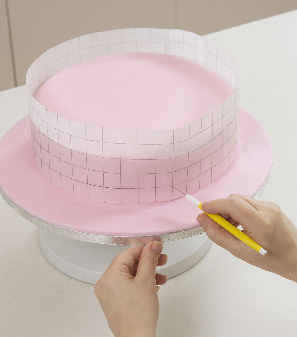 How to make and decorate a wedding cake   step by step guide 5  To make a template for the sides  wrap a piece of narrow baking  parchment around the largest cake and cut it so it fits perfectly around  the cake
