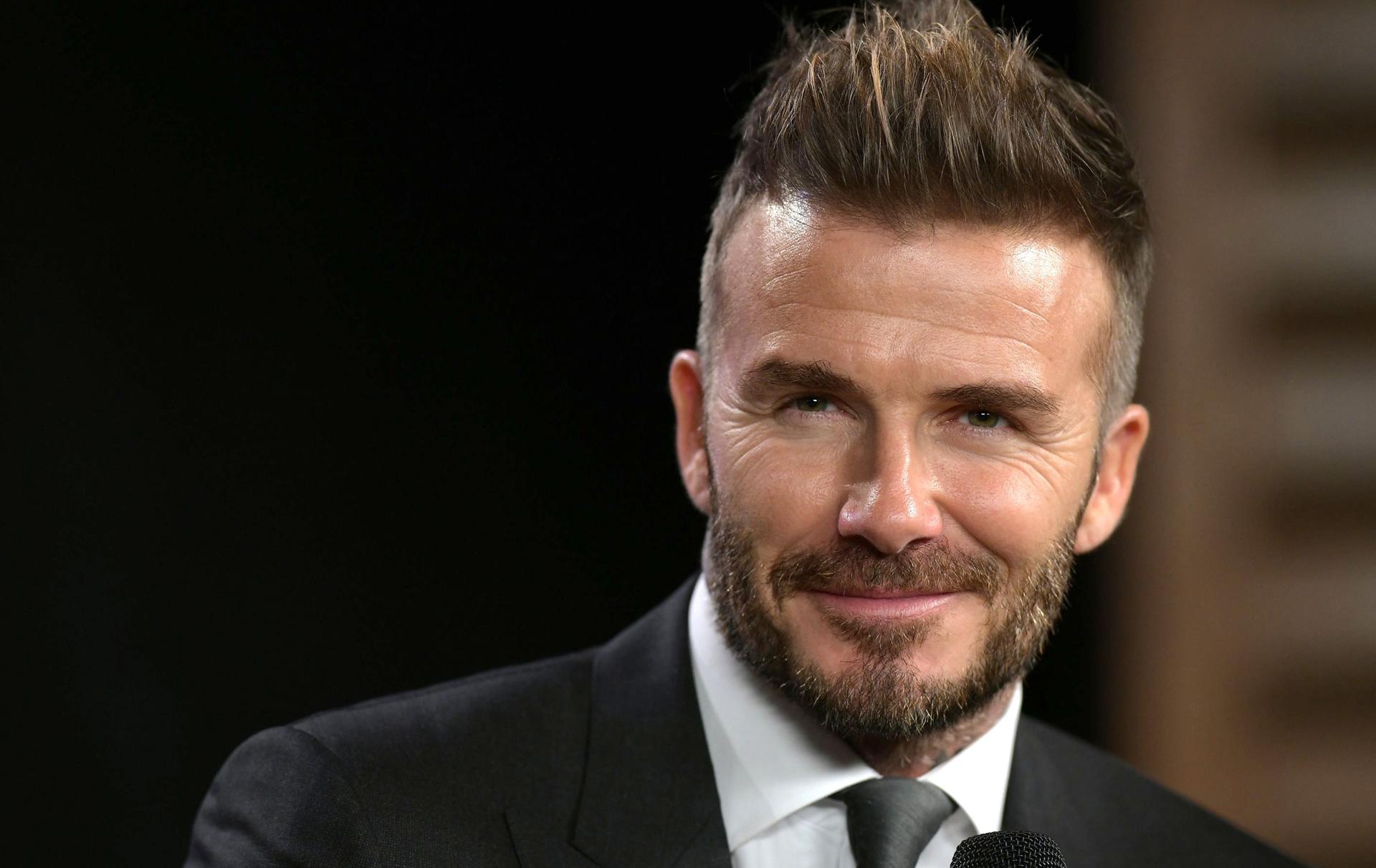 David Beckham fans defend photo of him kissing Harper