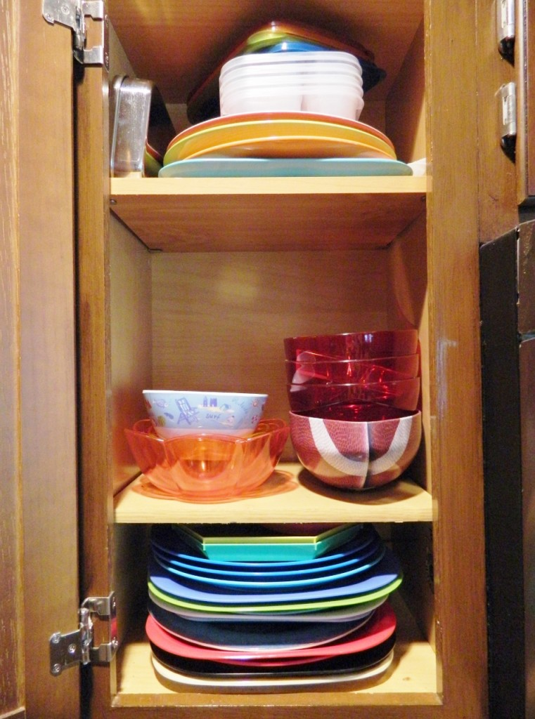 We keep our colored plates, bowls, & bento lunch containers in this cabinet in our kitchen