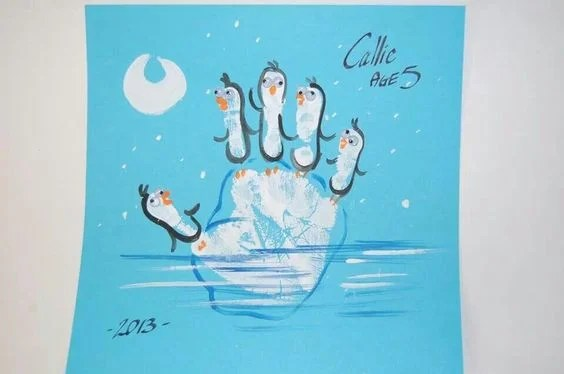 Handprint Penguins on a Iceburg....such a fun craft for the kids to make!