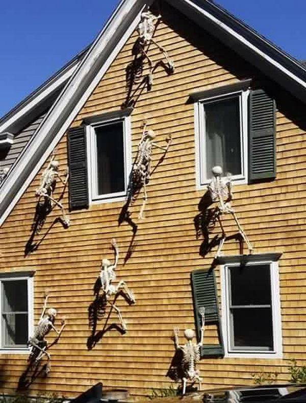 Skeletons climbing on a House...so cool! These are the BEST Halloween Home Decor & Craft Ideas!