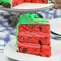 This watermelon cake looks just like a real watermelon! With green frosting and a red cake center with chocolate chips as seeds, you will adore this fun summer cake.
