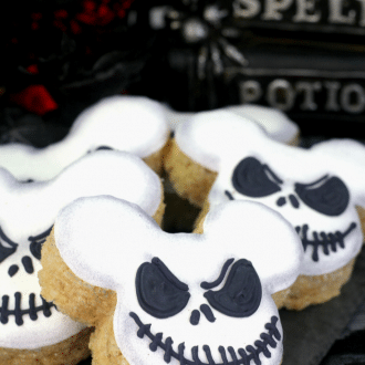 Up close picture of Jack Skellington Mickey Mouse Rice Krispie Treats on a black napkin