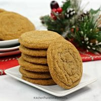 Gingerbread Molasses Cookies stacked on a small white plate