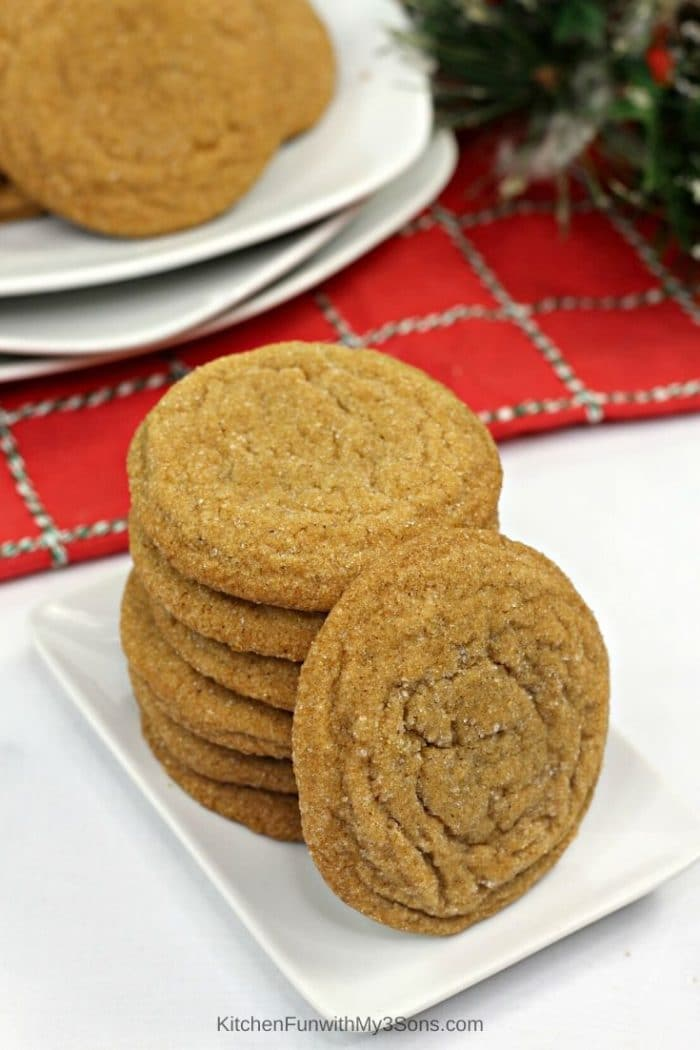 Gingerbread molasses cookies stacked on a white plate