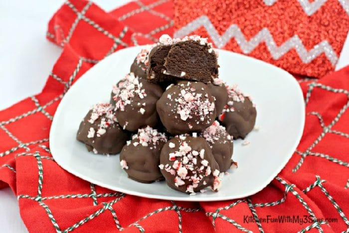Peppermint brownie truffles on a white plate sitting on red napkin