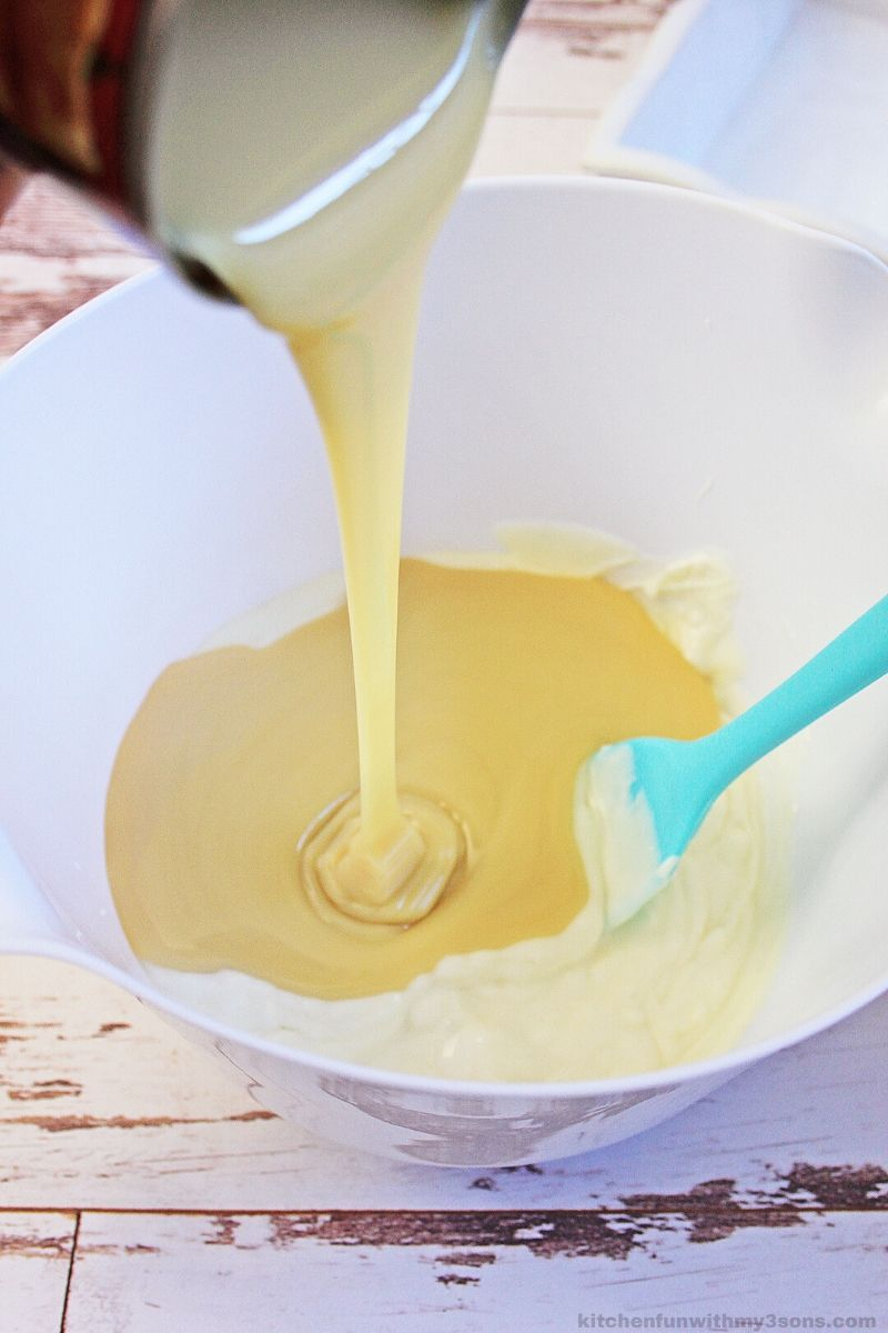 pouring sweetened condensed milk into chocolate