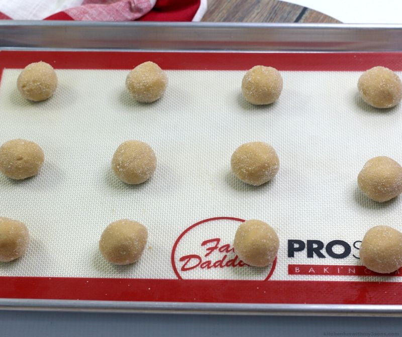 peanut butter cookie dough on a cookie sheet