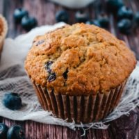 Blueberry Oatmeal Muffins with a white cloth