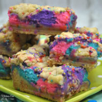 Unicorn Cheesecake Bars with a soft sugar cookie crust is a delicious dessert and perfect for a unicorn birthday party. Full of fun, bright colors and lots of flavor.