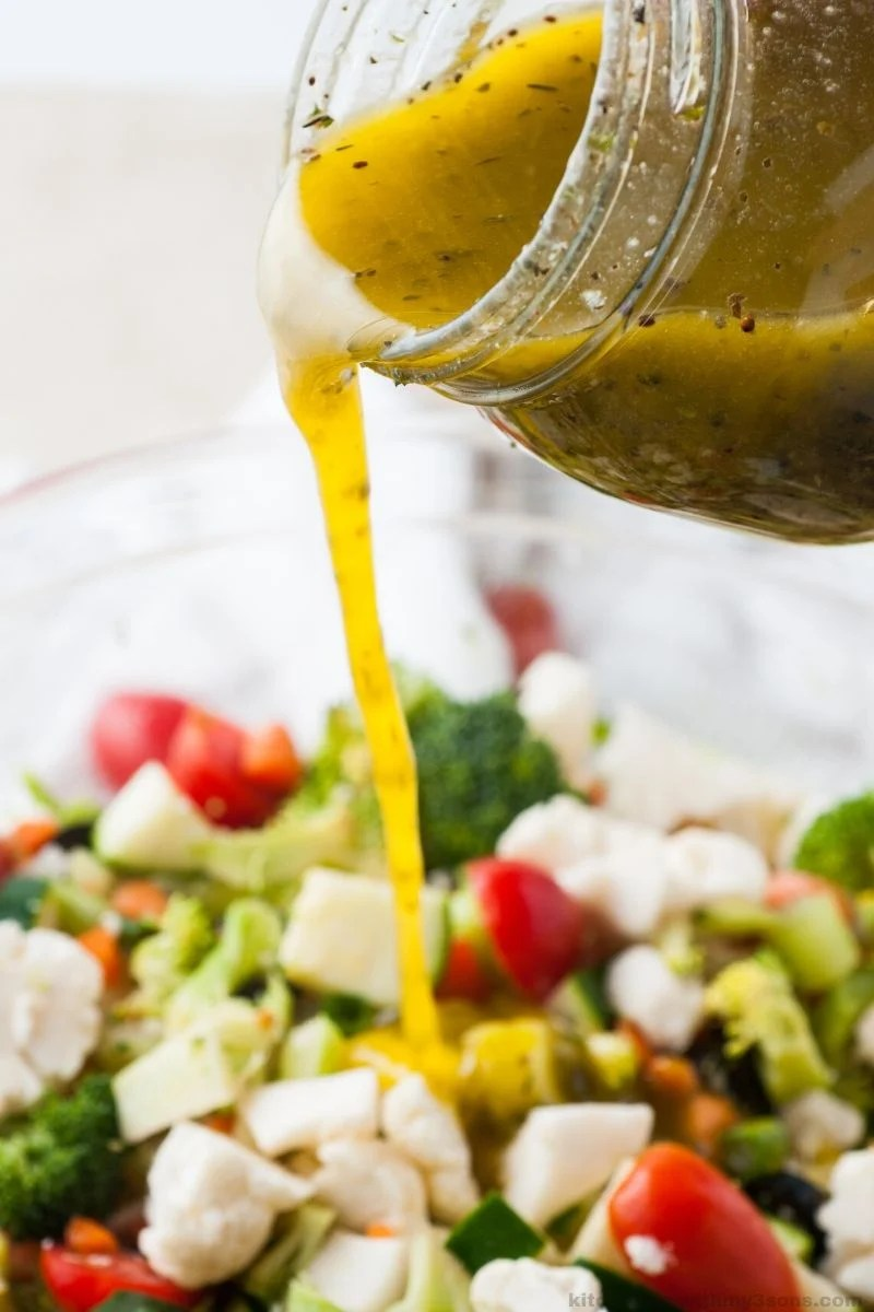 pouring homemade italian dressing